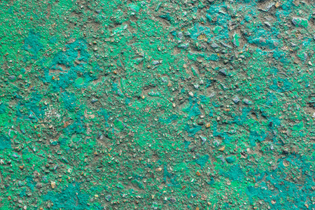 Vivid green painted rough concrete wall or floor texture background Stock Photo