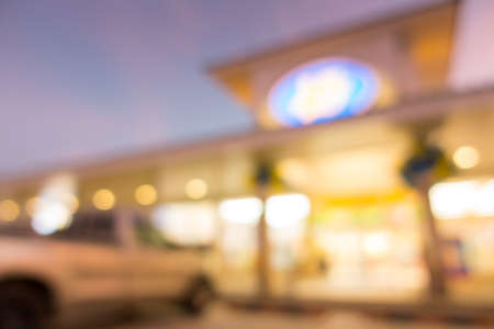 Abstract blurred in the front of convenience store in twilight.