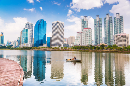 THAILAND - NOVEMBER 14 : Cityscape view with modern building in the park beside lake at Bangkok, on November 14, 2017 in Thailand.  Editorial