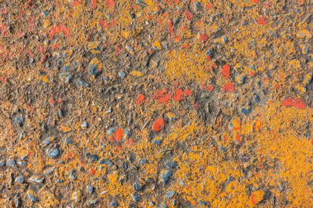 Vivid orange painted rough concrete wall or floor texture background