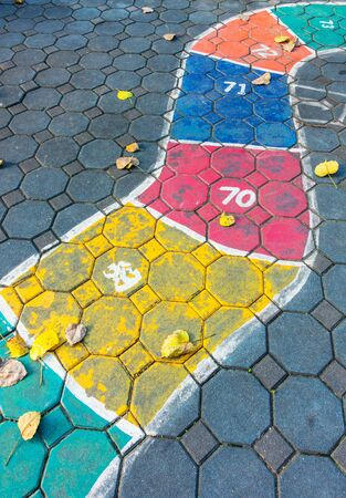 hopscotch on asphalt outdoors
