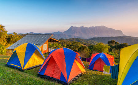 Camping tents on the top of mountain during sunrise at San pa kia to see Doi Luang Chiangdao, Chiang Mai, Thailand. Stock Photo