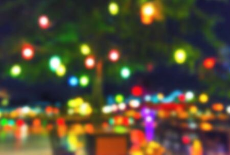 Abstract holiday background, defocused christmas lights background.