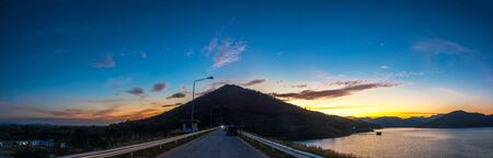 Sunset over the dam, Mae Kuang Dam at Chaing Mai province in THAILAND.