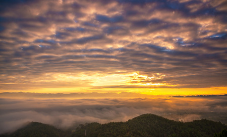 Sunrise in the mountain. At Wat Phrachao Luang Temple, Chiang Rai, Thailand. Stock Photo