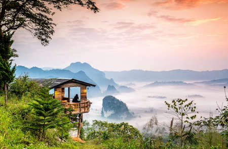Little home with misty mountains and sunrise, Phu Langka national park, Phayao province in Thailand.