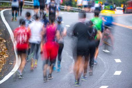 People running in a city marathon on street