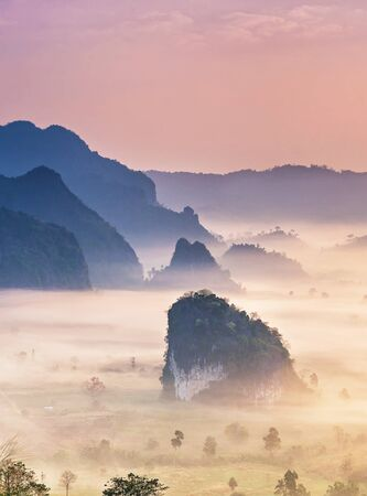Phu Langka national park, The landscape of misty mountains and at sunrise, Phayao province in Thailand.