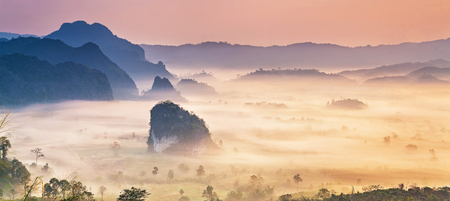 Panorama landscape of misty mountains and at sunrise, Phu Langka national park, Phayao province in Thailand.