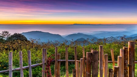 Landscape with sea of foggy awakening in a beautiful hills at Mon Son Doi Ang Khang National Park mountain viewpoint in Chaing Mai Province, Thailand.