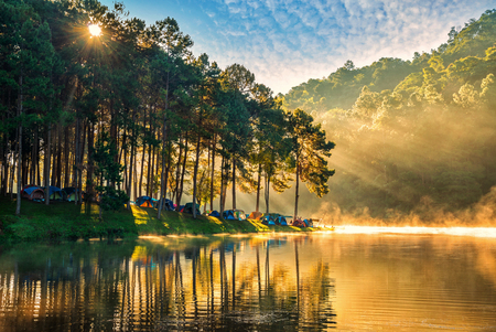 Morning in Pang Ung Lake, Tourist place where people come to vacation in the winter in North of Thailand, Selective Focus.