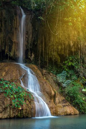 Phu Sang waterfall is a waterfall that is rare in Thailand. The hot waterfall is 35 -36 degrees Celsius, located on the mountain cliff in Phayao, Thailand. Stock Photo