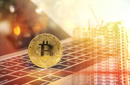 Double exposure Golden bitcoin on laptop with building background, Blockchain , cryptocurrencies and distributed ledger technology Stock Photo - 98850037
