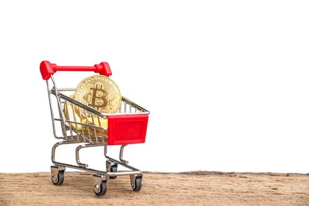 Shopping trolley cart with gold coins Bitcoin, Blockchain , cryptocurrencies investment security and strategy. Virtual cryptocurrency concept. Stock Photo