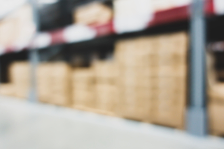 Blurred large furniture warehouse with row of aisles. Industrial storehouse interior. Inventory, wholesale, logistic, export with vintage filter Stock Photo - 100950722