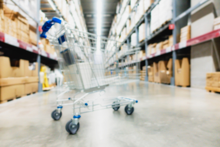 Blurred shopping cart or trolley in large warehouse inventory ,Space for background.