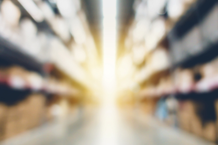 Blurred large furniture warehouse with row of aisles. Industrial storehouse interior. Inventory, wholesale, logistic, export with vintage filter Stock Photo
