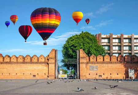 CHIANG MAI, THAILAND - MAY 18, 2018 : Colorful hot air balloons flying over THA PHAE GATE of Chiang Mai City in the morning. Gate is the most famous landmarks in the city