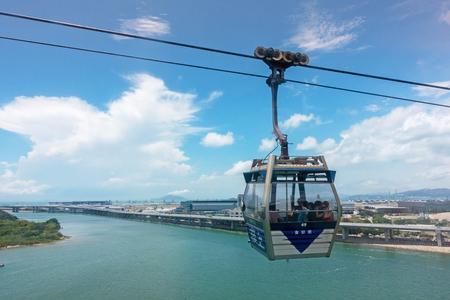 HONG KONG - MAY 5: Ngong Ping Cable Car on Lantau island of Hong Kong. Long distance cable car across the mountain in Hong Kong, Ngong Ping cable car.