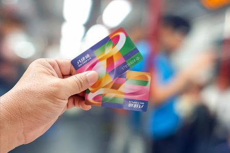 Hong Kong , CHINA - MAY 5, 2018. Hand holding an Octopus Smart card in MTR train in Hong Kong