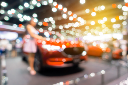 Abstract blurred photo of motor show, car show room for background.