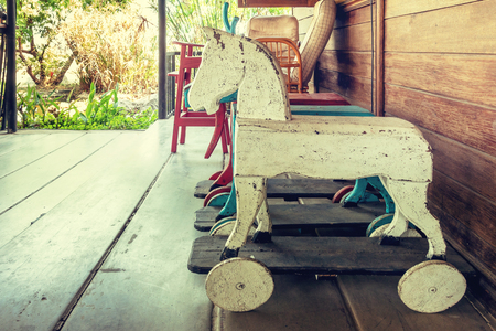 Vintage rocking hourse in old house. Old rustic toy in wooden house Stock Photo