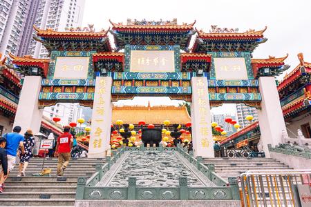HONG KONG, CHINA - MAY 5, 2018: Unidentified people enter Sik Sik Yuen Wong Tai Sin temple at Kowloon in Hong Kong, China.