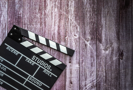Clapperboard on wooden background.mock up, top view. Flat lay of cinema items. Stock Photo