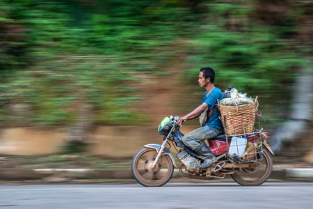 UTTARADIT, THAILAND- AUGUST 13, 2018 : Movement Man driving motorcycle pick up durian from mountain to market, Lub Lae in Uttaradit Province, Thailand.  Long Lub Lae is the famous Durian of Uttaradit Province, Thailand Stock Photo