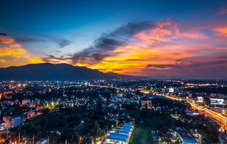 CHIANG MAI, THAILAND- AUGUST 7, 2018 : Aerial Panorama View of Chiang Mai City with sunset and twilight sky. Stock Photo