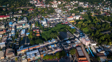 CHIANG MAI, THAILAND- AUGUST 7, 2018 : Top view aerial photo from flying drone of Chiang Mai City with buildings, transportation.