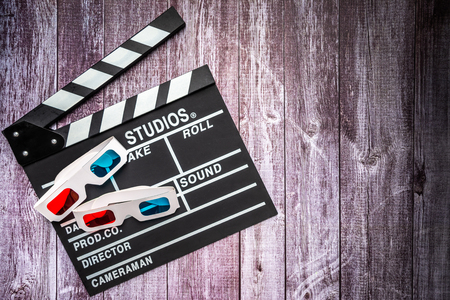 Clapperboard and 3d glasses on wooden background.mock up, top view. Flat lay of cinema items.