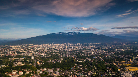 CHIANG MAI, THAILAND- AUGUST 7, 2018 : Aerial Panorama View of Chiang Mai City with sunset and clouds, Thailand. Stock Photo