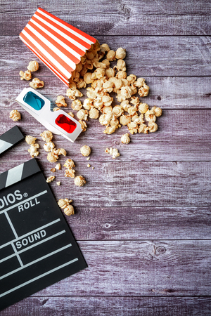 Flat lay of cinema items, clapperboard, 3d glasses and popcorn. mock up. top view. Stock Photo