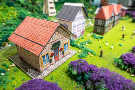 BANGKOK, THAILAND -APRIL 20, 2018: Miniature model of European village and people. Small model of beautiful European style traditional house.