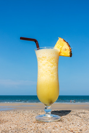Pineapple smoothies on tropical background, Fruit cocktails on paradise beach.