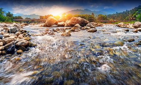 Streaming water and rocks in sunset , Ban Khiri Wong village, Nakhon Si Thammarat, Thailand. Stock Photo