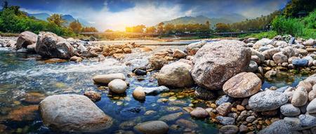 Streaming water and rocks in a small river , Ban Khiri Wong village, Nakhon Si Thammarat, Thailand, landscape and panorama shot.