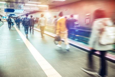 Anonymous blurred people rushing in subway train,Seoul in South Korea.
