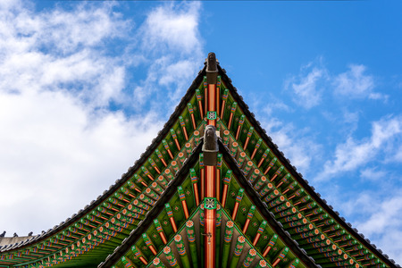 Gyeongbokgung palace roof with sky and cloud in Seoul City, South Korea. Stock Photo