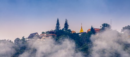View of Wat Phra That Doi Suthep Temple at morning and misty on the top of Doi Suthep mountain in Chiang Mai, Thailand.