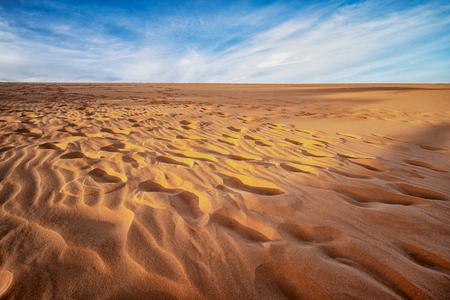Red sand dunes in Binh Thuan near the town of Mui Ne, Vietnam. Mui Ne is popular travel destination with long coastline.