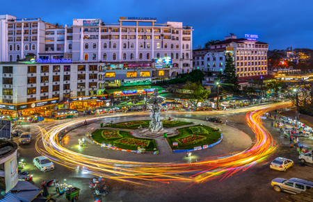 DA LAT CITY, VIETNAM - JANUARY 18, 2019: Speed Traffic - light trails  at Da lat night market with long exposure.  Da Lat is one of tourism and leisure city in Viet Nam