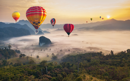 Colorful hot air balloons flying over mountain at Phu Langka national park, Phayao province in Thailand.