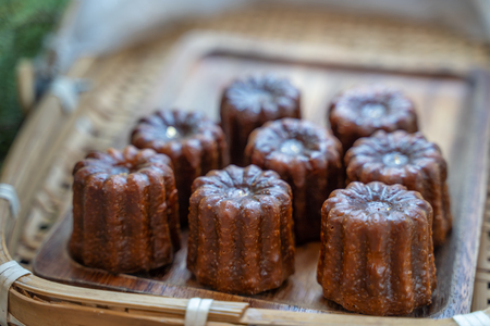Caneles de bordeaux is a small pastry with rum and vanilla, traditional French sweet dessert. 版權商用圖片