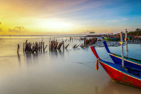 Front view of bow wooden fishing boat and sea background in sunrise with copy space