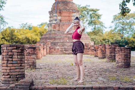 Muay thai, Asian woman Thai boxing, Thailand. Asia thai boxer muay thai with traditional hemp ropes.
