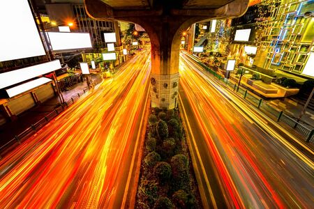 Night light with long speed shutter of traffic in front of Siam Discovery. Siam Discovery is one of the most popular shopping centers in Siam Area in Bangkok, Thailand. Stock Photo
