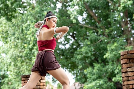 Muay thai, Asian woman Thai boxing, Thailand. Asia thai boxer muay thai with traditional hemp ropes.