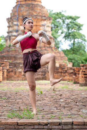 Muay thai, Asian woman Thai boxing ,Thailand. Asia thai boxer muay thai with traditional hemp ropes.
